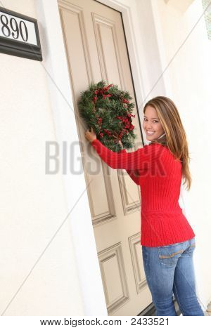 Woman And Christmas Wreath
