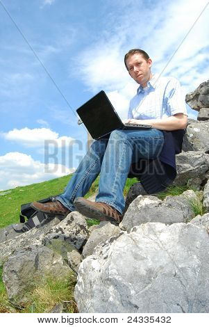 Young businessman and laptop