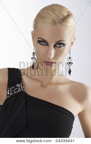 Portrait Of Blond Girl In Black Dress