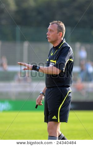 KAPOSVAR, HUNGARY - SEPTEMBER 24: Zsolt Szabo (referee) in action at a Hungarian National Championship soccer game - Kaposvar (white) vs Debrecen (red) on September 24, 2011 in Kaposvar, Hungary.