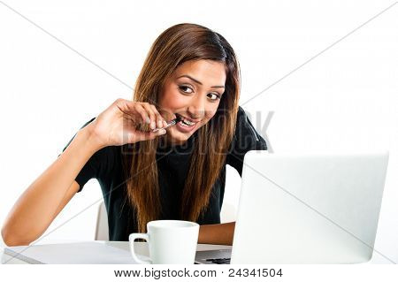 Attractive young asian indian teenage woman, studying with laptop