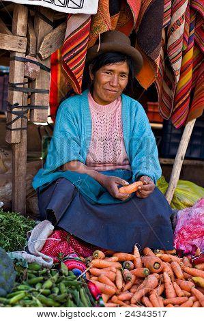 Peruvian Woman Sells Vegetables At A Market, Pisac, Peru