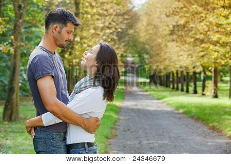 Young Couple Walking in autumn park