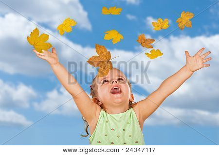 Happy Shouting Little Girl With Falling Autumn Leaves