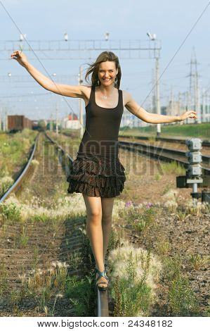 Beautiful Girl Walking on Rails