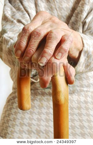 Old Ladies hands with walking stick