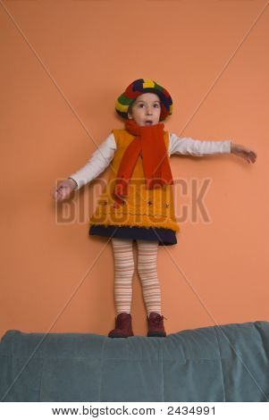 Litle Girl In Orange Dress Dancing