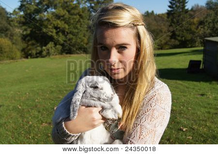 Girl Cuddling her Rabbit