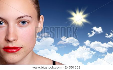Image of young woman against blue sky background