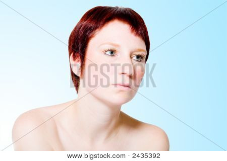 Studio Portrait Of An Uninterested Young Woman With Short Hair