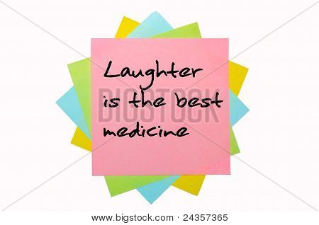 """Proverb """"laughter Is The Best Medicine"""" Written On Bunch Of Sticky Notes"""