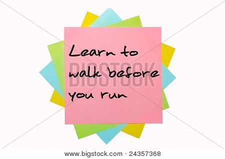 """Proverb """"learn To Walk Before You Run"""" Written On Bunch Of Sticky Notes"""