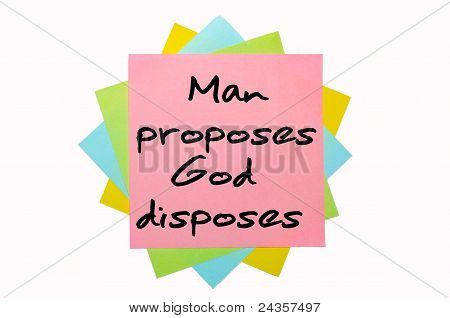 "Proverb ""man Proposes, God Disposes"" Written On Bunch Of Sticky Notes"