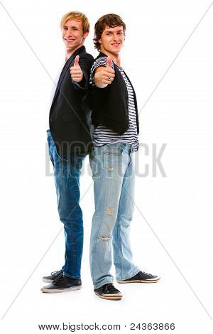 Two Modern Young Men Showing Thumbs Up. Isolated On White