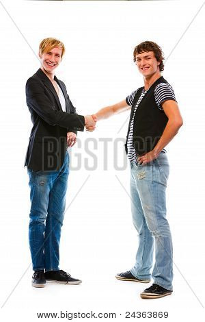 Two Modern Teenage Boys Shaking Hands. Isolated On White