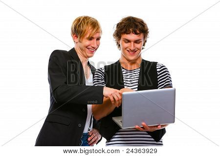Two Smiling Young Men Looking In Laptop. Isolated On White