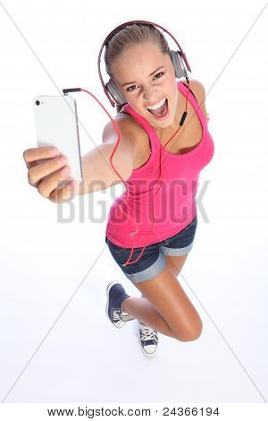 Happy Sexy Teenage Girl Has Music Fun With Phone