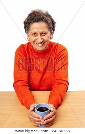 Old Woman Drinking From A Cup