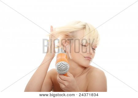 Young blonde woman using hair drier isolated on white