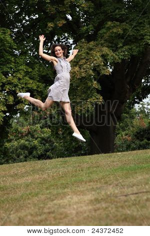 High Flying Jump For Joy Beautiful Girl In Park