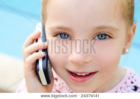 child little girl talking mobile phone in pool with happy gesture