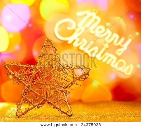 Golden star with Merry Christmas written in lights background