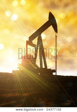 Oil Well Against Bright Sun Flare.