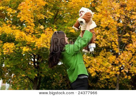 Happy Mother With Child In City Park