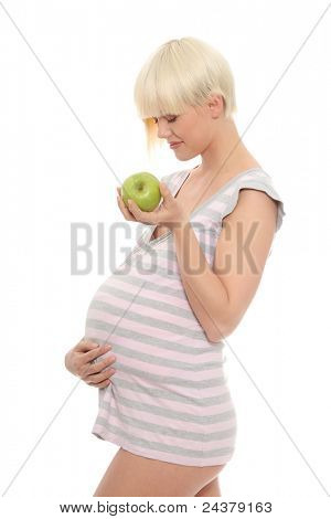 Young pregnant woman with green apple, isolated on white background