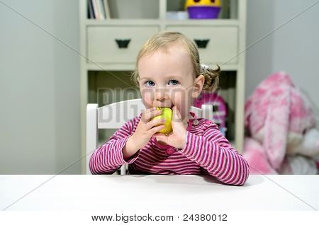 Little Girl Eating Green Apple