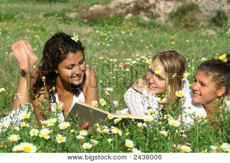 Group Of Teenagers Reading Book Or Bible