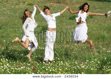 Young Happy Women Jumping For Joy