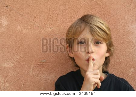 Child With Finger To Lips