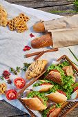 Picnic Basket Full With Sandwiches, Baguette And Croissant On A Homespun Tablecloth, Summer Season,  poster