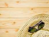 Sunglasses And Beach Hat On Wooden Background poster