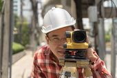 Civil Engineer Land Survey With Tacheometer Equipment Or Theodolite. Worker Checking Construction Si poster
