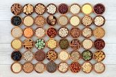 Large macrobiotic health food selection of seeds, nuts, grains, legumes, cereals and whole wheat pas poster