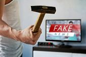 Man Wants To Break The Tv. Guy Swung A Hammer At The Screen. . Fake News On The Tv Screen, Hoax Conc poster