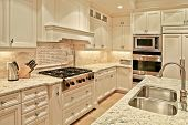 foto of workbench  - Modern luxury  kitchen with white cabinets and marble countertops - JPG