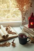 Autumn Still Life. Books, Leaves, Cuo Of Tea And Dry Tiny Flowers In Vase Red Candlestick With A Bur poster