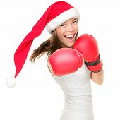 image of boxing gloves  - Christmas woman hitting wearing boxing gloves and red santa hat - JPG