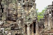 Carved Stone Face Of Ancient Buddhist Temple Bayon In Angkor Wat Complex, Cambodia. Ancient Architec poster