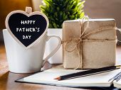 Happy Fathers Day Concept. Coffee Cup With Gift Box, Heart Tag With Happy Fathers Day Text, Noteboo poster