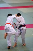 stock photo of shotokan  - The karate kids fighting for the competition - JPG