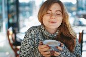 Coffee Concept. Beautiful Woman Enjoying A Cup Of Coffee With Closed Eyes. Natural Reddish Girl With poster