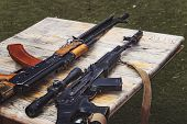 Постер, плакат: Arms Trafficking Different Rifles On The Counter In The Gun Shop Clandestine Sale Of Weapons Ille