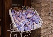 Little And Colorful Lavender Sachets Exposed Outside Of A Gifts Shops poster