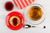 Pancake With Jam In Saucer, Bowl With Strawberry Jam, Tea In Cup, Napkin, Spoon On Wooden Table. Top poster