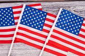 Collection Of Mini Flags Of Usa Close Up. Small Flags Of Usa On Wooden Background. Symbol Of Nation  poster