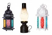 Two Traditional Lamps From Morocco White And Black With Colored Glasses And An Old Kerosene Lamp Wit poster